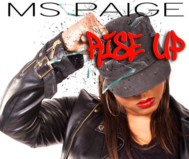 "Ms Paige has teamed up once more with Enos Peniston (a.k.a. Mandrike) of COZMIKNATION PRODUCTION to share with you her first 2014 release.  In celebration of what-would-have-been Bob Marley's 69th birthday, Ms Paige presents a positive message through the lyrics of this conscious reggae track entitled RISE UP.     Written and performed by Ms Paige, RISE UP is featured on the Wreckless Riddim.     ""With all of the terrible things that generations before us had to endure, it blows my mind that the ignorance of racism still lives today. The colour of one's skin does NOT define whether or not they should be held in higher regard than another. It is time to rise above stereotypes, rise above hate, RISE UP!""  ~ Ms Paige"
