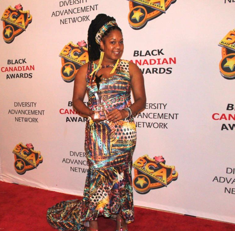"Decked out in a drop-dead couture outfit the inspired creation of  Canadian based ""Dab Design"" Tasha T looked stunning throughout the evening. When interviewed about this latest honor the petite songstress known for her big voice and conscious lyrics said ""more than anyone could imagine I am extremely thankful to the Black Canadian Awards Committee for recognizing and nominating me for the award.  She went on to say that ""I work non-stop writing to create statement music that hopefully will make a difference in the lives of all listeners and touring to promote my message. This award strengthens my energy and resolve to continue moving in the direction that I am headed, up-up-up!"""