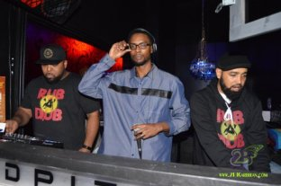 photo of Highlanda Sound's Kahlil Wonda holding the microphone with DJ Passport (Right) and AGARD (left)