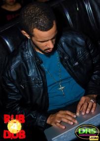 photo of Innocent Sound, Dappa Lee with his laptop at RubADubATL Bob Marley Birthday Party